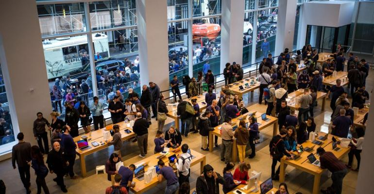 Employees assist customers with Apple Inc. iPhone X smartphones during the sales launch at a store in New York, U.S., on Friday, Nov. 3, 2017. Photographer: Michael Nagle/Bloomberg