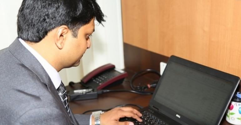 Executive working on a laptop