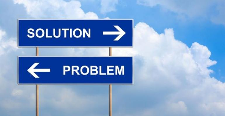 Solution and Problem direction road sign with clouds in background