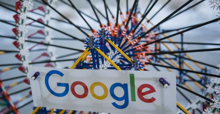 Signage is displayed on a K'nex Industries Inc. toy ferris wheel in the lobby of the new Google Inc. campus in Boulder, Colorado, U.S., on Wednesday, Feb. 21, 2018.  Photographer: Daniel Brenner/Bloomberg