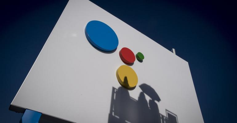 Shadows of attendees are seen on a wall at the Google Inc. booth during the 2018 Consumer Electronics Show (CES) in Las Vegas, Nevada, U.S., on Thursday, Jan. 11, 2018. Electric and driverless cars will remain a big part of this year's CES, as makers of high-tech cameras, batteries, and AI software vie to climb into automakers' dashboards. Photographer: David Paul Morris/Bloomberg