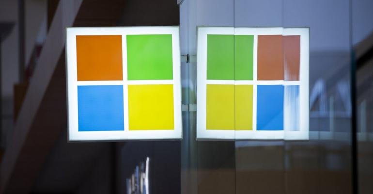 Signage is displayed outside of a Microsoft Corp. store in Bellevue, Washington, U.S., on Thursday, Jan. 26, 2017. Microsoft Corp.'s second-quarter sales and profit exceeded analysts' projections, bolstered by rising customer sign-ups for Azure and Office cloud-computing services. Photographer: David Ryder/Bloomberg