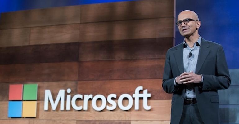 Nadella with Microsoft Logo