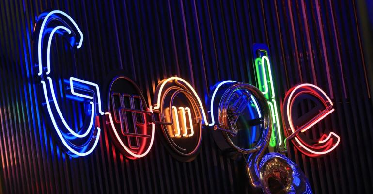 The Google Inc. logo hangs illuminated at the company's exhibition stand at the Dmexco digital marketing conference in Cologne, Germany, on Wednesday, Sept. 14, 2016. Photographer: Krisztian Bocsi