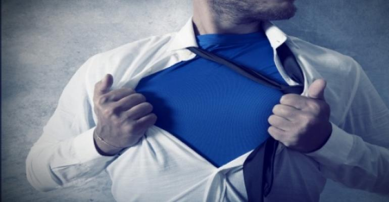 Image of man tearing off his dress shirt to reveal blue undershirt, like Superman