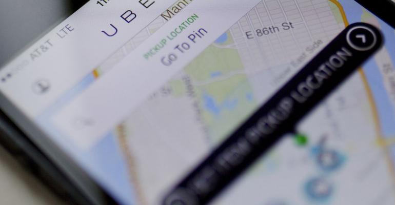 Th Uber Technologies Inc. car service application (app) is displayed for a photograph on an Apple Inc. iPhone in New York, U.S., on Wednesday, Aug. 6, 2014. Photographer: Victor J. Blue