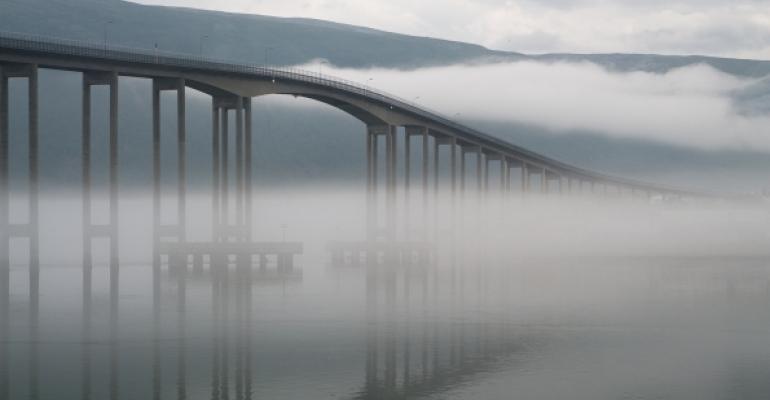 bridge surrounded by fog