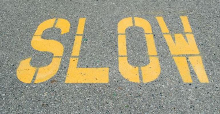 Slow written in yellow on street