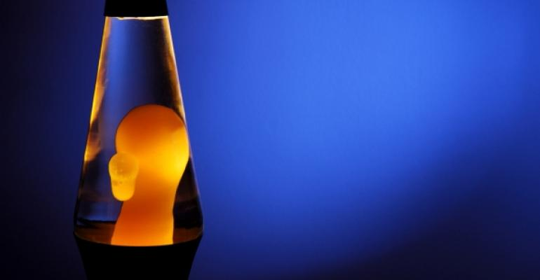 Lava lamp with yellow blob on blue background