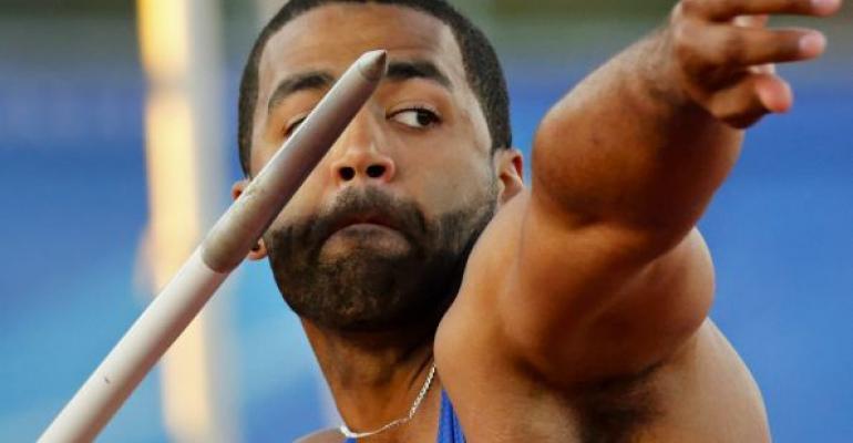 man throwing javelin