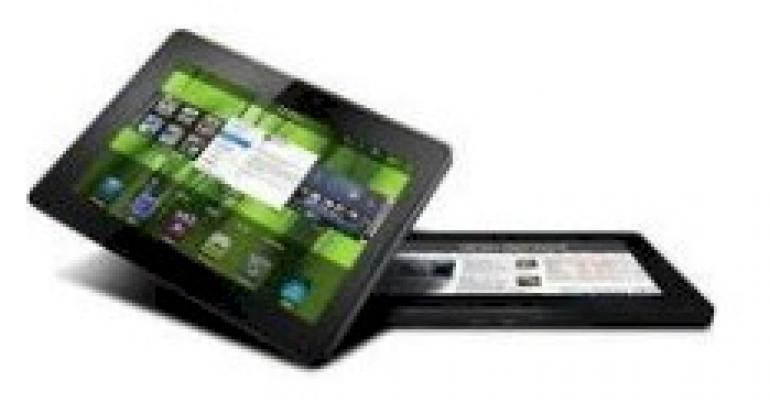 tablet showing green home screen angled above another tablet lying down