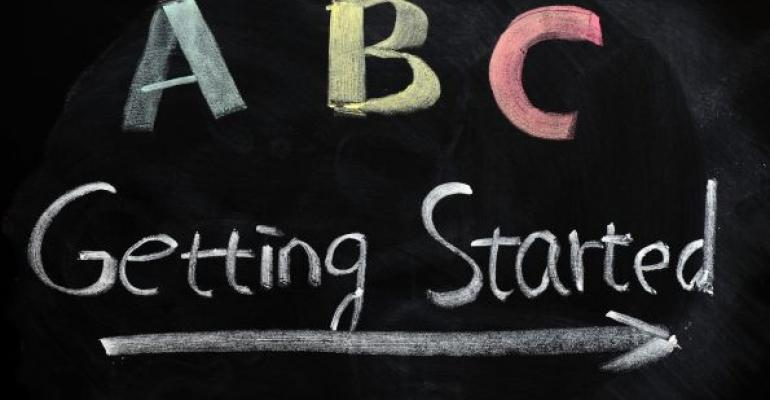 Black chalkboard reading ABC Getting Started with arrow beneath