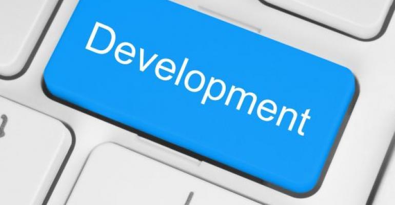 Blue key with white text Development