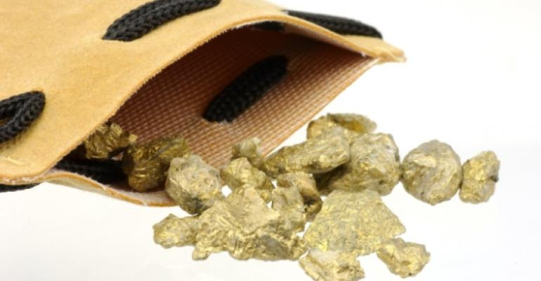 gold nuggets spilling from a leather bag