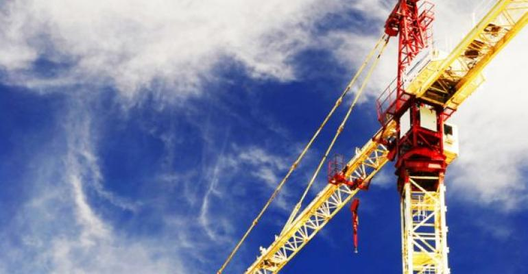 Construction crane with blue sky background