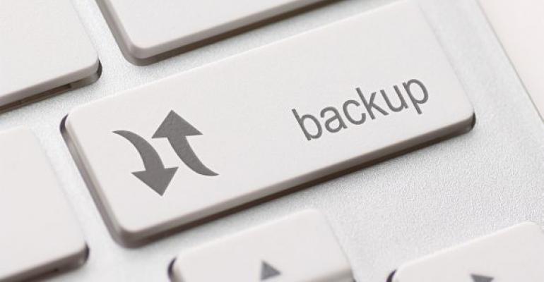 computer keyboard key labeled backup