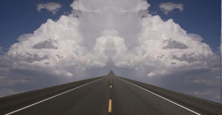 two lane road seeming to stretch to the clouds