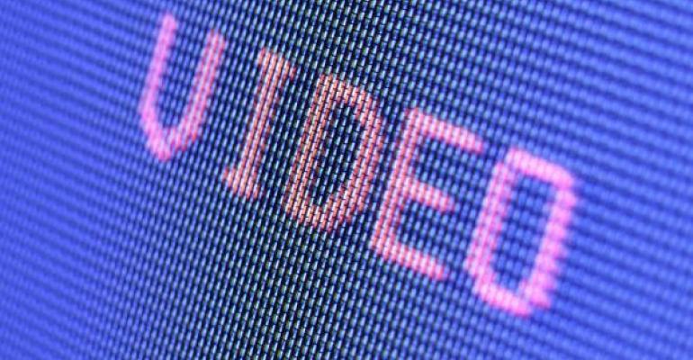 video written in pink on blue screen