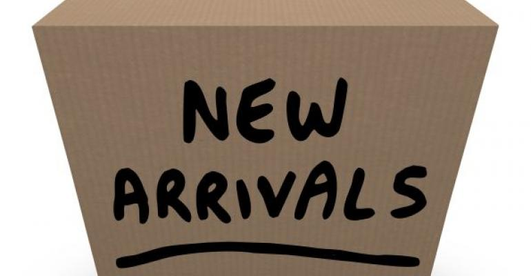 brown cardboard box labeled New Arrivals
