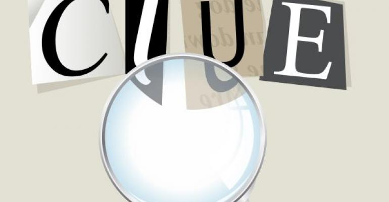 magnifying glass looking at the word clue