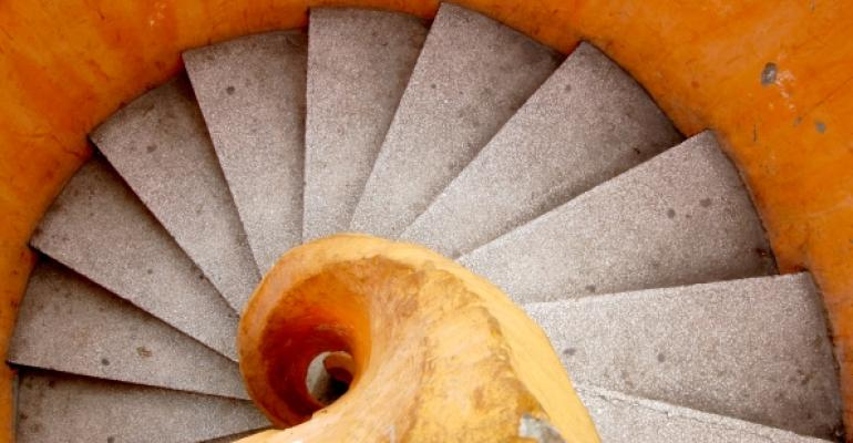tan and grey spiral stairs looks similar to a shell