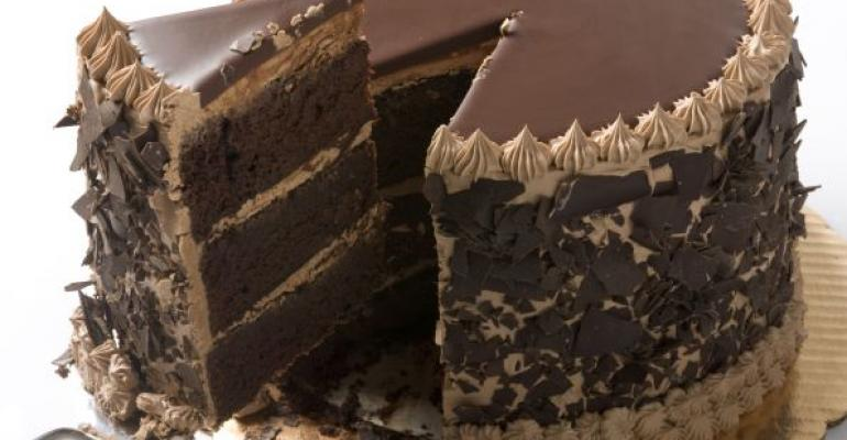Chocolate cake with slice being taken out