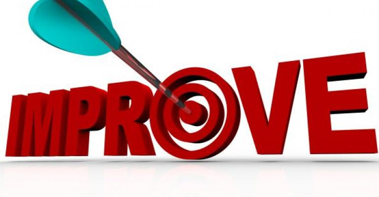 red word IMPROVE with target and arrow in center of O on white background