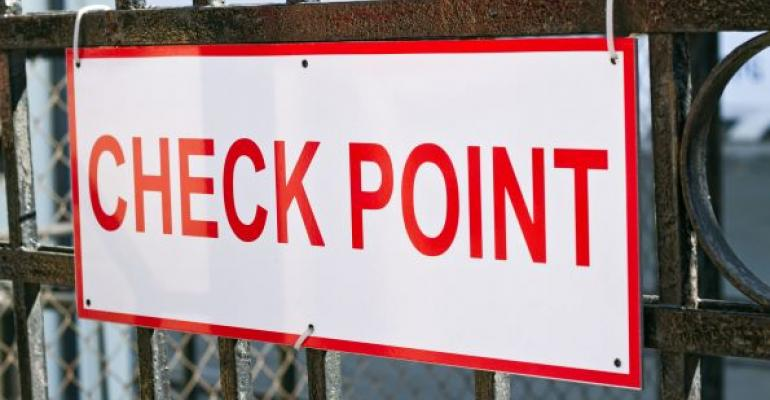 Check Point sign on metal fence