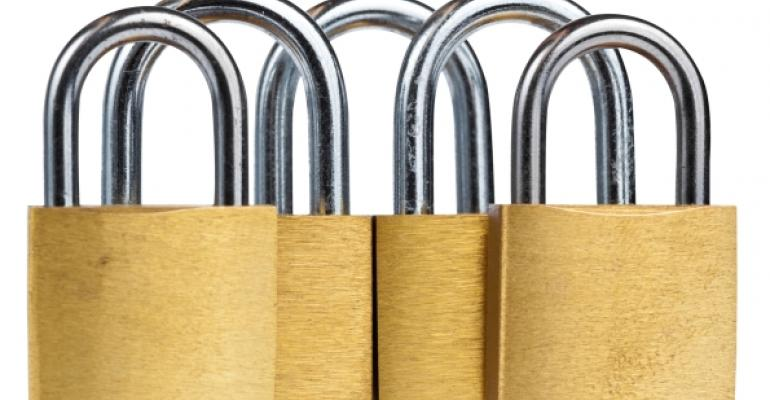 five gold padlocks upright white background