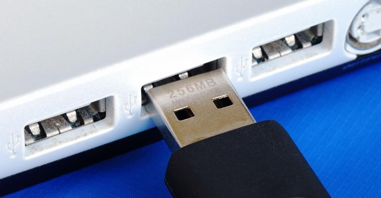 USB jump drive being plugged into computer