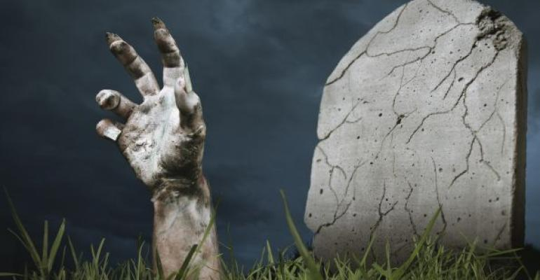 zombie hand coming out of a grave