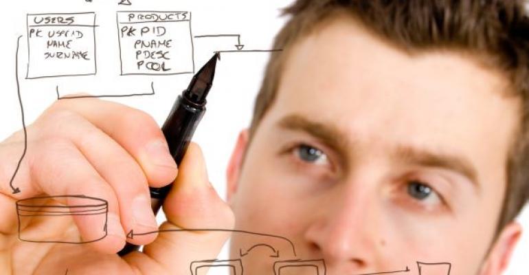 Man drawing a SQL Server database plan