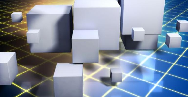 white cubes of assorted size on blue and yellow data grid background