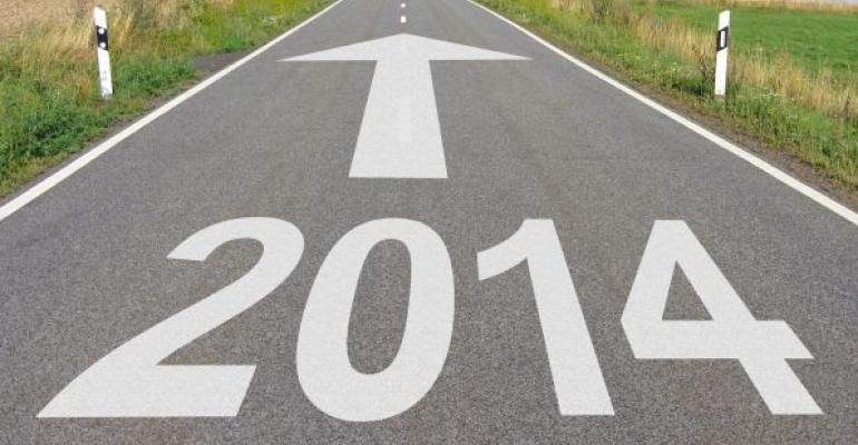 2014 written in white on a road with a forward arrow