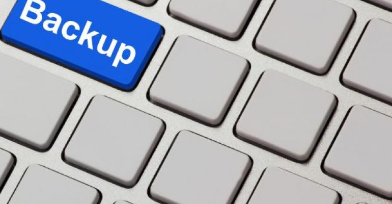 blue backup key on grey computer keyboard