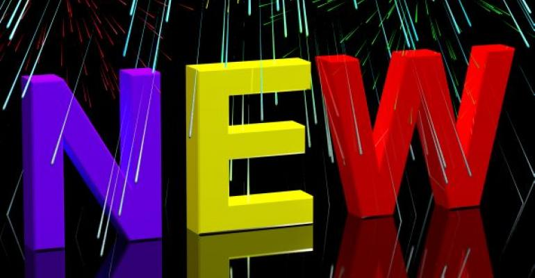 multicolored letters NEW on black background with firework sparks all around