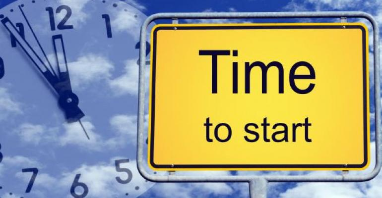 Time to start sign with clock and clouds in background