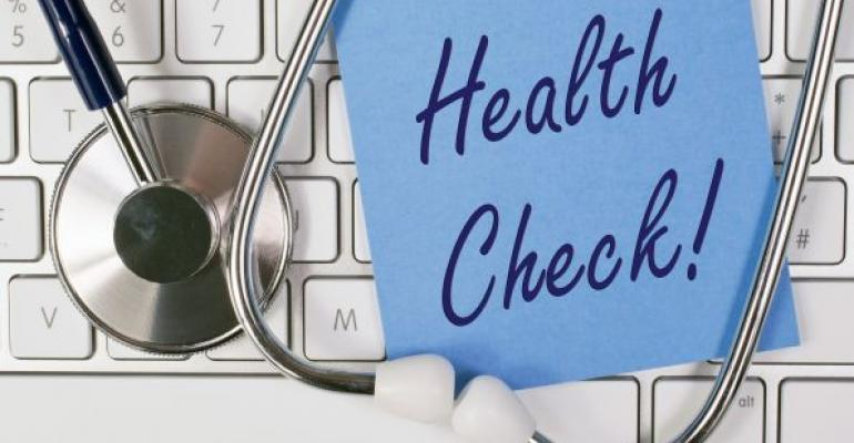 Health check note on computer keyboard