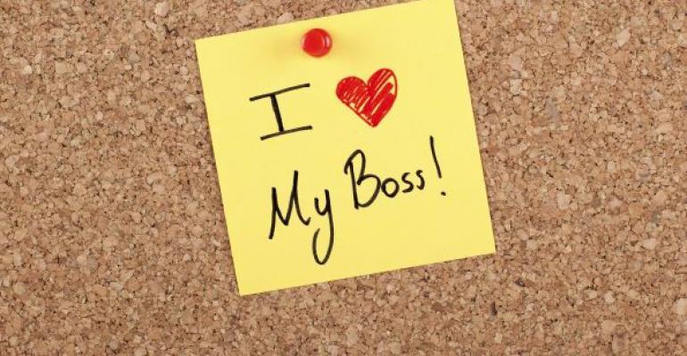 sticky note on bulletin board saying I love my boss
