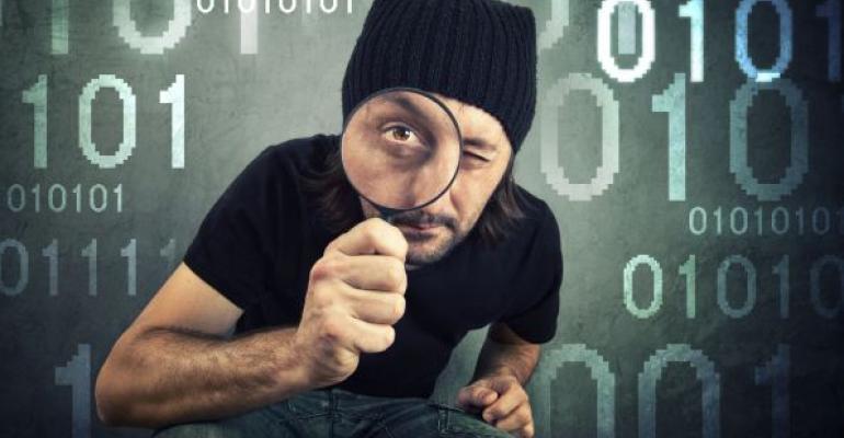 detetecitve dressed in black looking at data