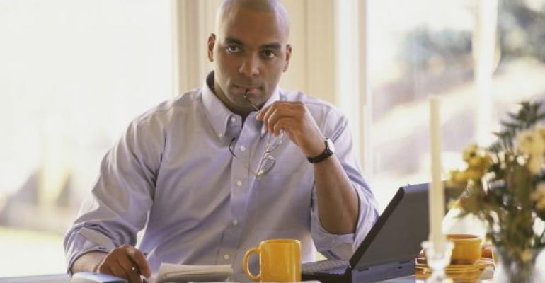 Man contemplating costs of licensing SQL Server per VM or per VM host