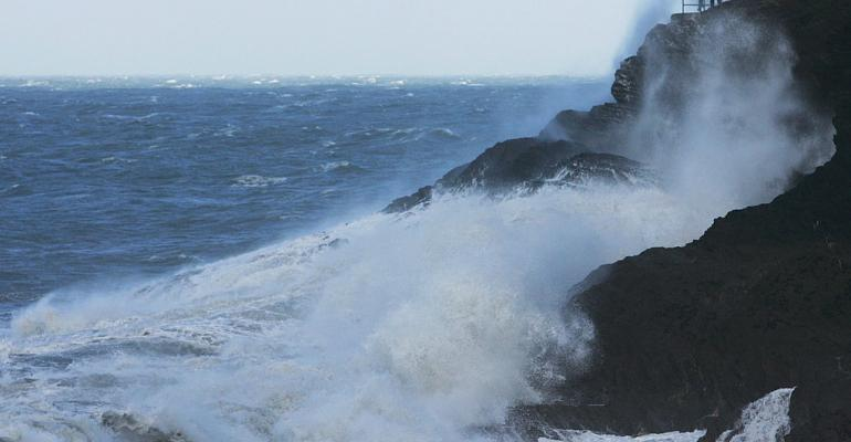 People walking on the cliffs are hit by waves in Ilfracombe United Kingdom where Hutchins is based