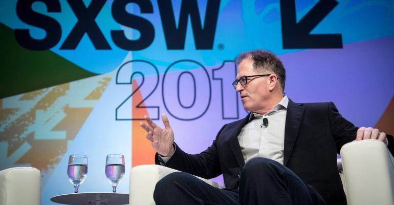 Michael Dell, chairman and chief executive officer of Dell Inc., speaks during a keynote session during the South By Southwest (SXSW) conference in Austin, Texas, U.S., on Saturday, March 10, 2018. Amid the raucous parties and speed networking at the annual festival that draws people from technology, film, and music to Austin, Texas, there will be some soul searching about gender discrimination, sexual harassment and how to fix the broken workplace culture. Photographer: David Paul Morris/Bloomberg