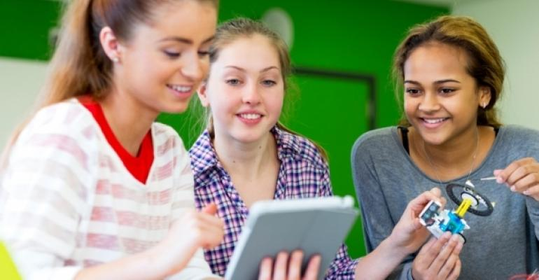 young women collaborating in tech